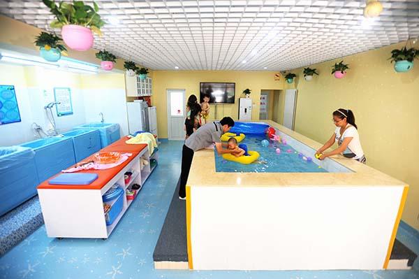婴儿游泳馆热水成就空气源热水器发展